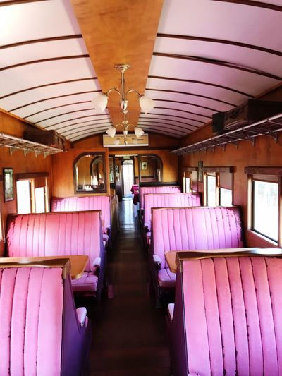 First class cabin - century 19 Past Times. Old Train Historical The Traveler - 2018 EyeEm Awards Indoors  Seat In A Row Ceiling No People Lighting Equipment The Architect - 2018 EyeEm Awards Pink Color Architecture Vehicle Seat Vehicle Interior Transportation Purple Luxury