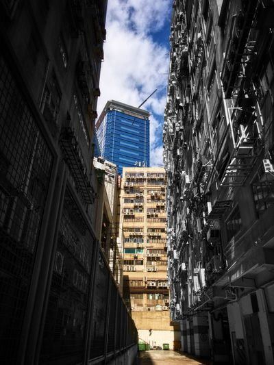 Architecture Built Structure Building Exterior City Low Angle View Tall - High Skyscraper Sky Tower Building Story City Life Office Building Modern Cloud - Sky Narrow Development Financial District  Color Manipulation Tall Downtown District Hong Kong HongKong IPhone Iphonephotography IPhoneography