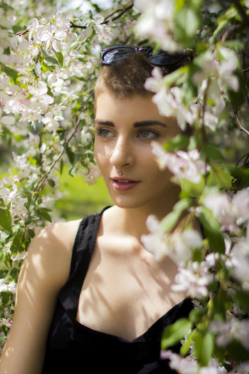 Beautiful Woman Beauty In Nature Branch Close-up Day Flower Flowers Fragility Freshness Growth Model, Nature One Person Outdoors Real People Tree Young Adult Young Women