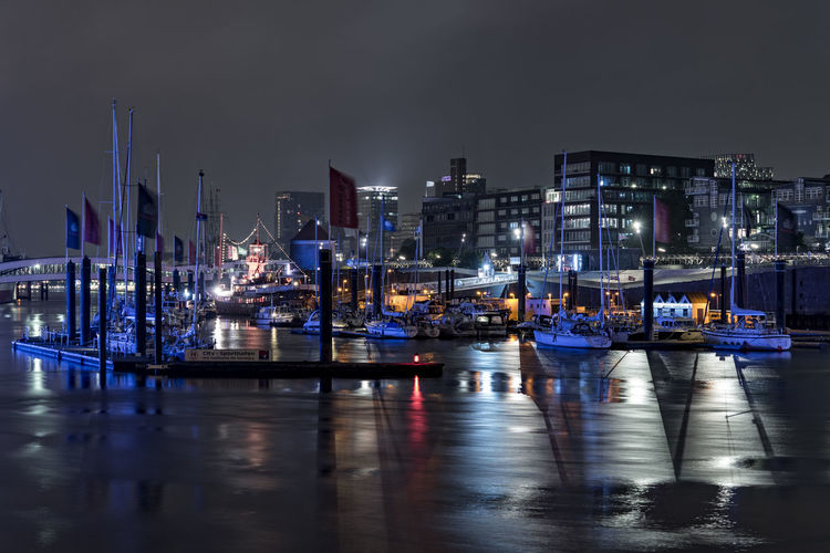 Hamburg harbour Artificial Light Blue Blue Lights  Bridges Cityscape Deep In The Night Elbe River Flaggs Hamburg Harbour Iluminated Landungsbrücken  Modern Architecture Night Sky Pontons Sailboat Sailing Ship Sport Harbour Water Water Reflections Windy Evening Überseebrücke