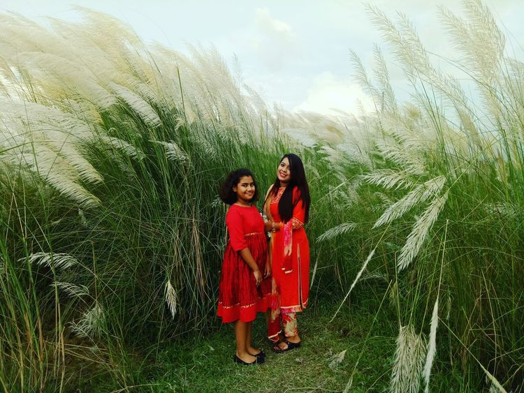 Togetherness Lifestyles Childhood Bonding Girls Red Field Day Person Casual Clothing Outdoors Nature Fashionable Missing Beauty Country Road Make-up Photography In Motion Looking At Camera Confidence  Fashion Kashful Young Women Awsomephotography