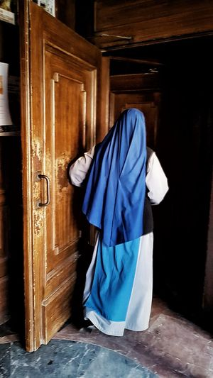 Monja Catedral Vic Cataluña Clothing Entrance Door Indoors  Wood - Material No People Architecture Blue Bathroom Hotel Traditional Clothing Lifestyles Building Domestic Room Doorway Full Length Built Structure Capture Tomorrow EyeEmNewHere