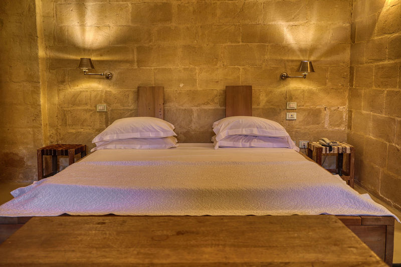 Matera 2018 Indoors  Architecture Built Structure Bed Furniture Seat No People Building Absence Illuminated Wall - Building Feature Relaxation Table Chair Religion Wood - Material Place Of Worship Day Pillow Luxury