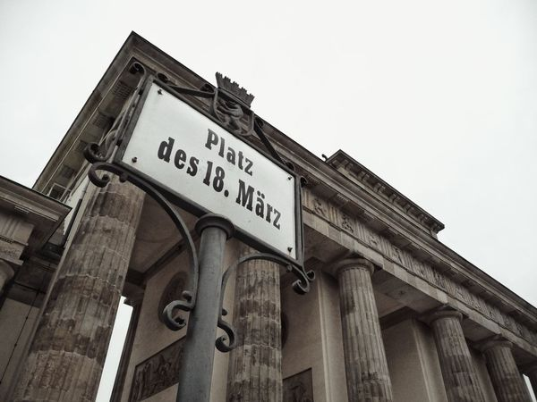 Low Angle View Architecture Built Structure History The Past No People Text Building Exterior Travel Destinations Architectural Column Sky Outdoors Day Capture Berlin Berlin Germany Bradenburgertor My Point Of View Dramatic Angles Street Photography Street Sign EyeEm Gallery EyeEm Best Shots