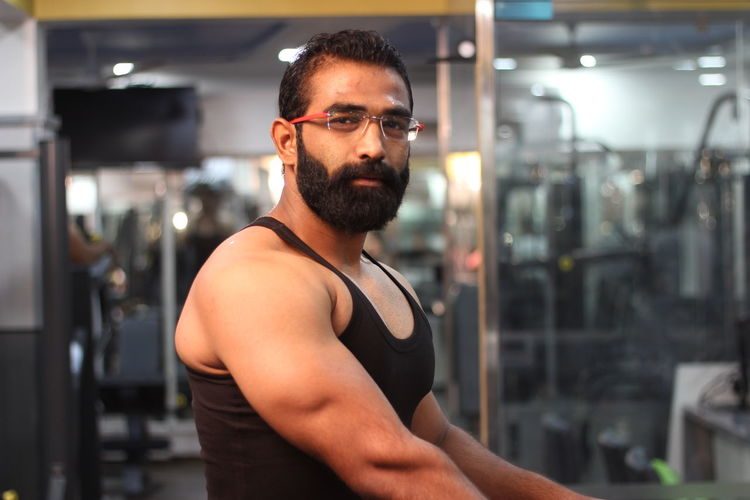 Portrait of smiling bearded man at gym