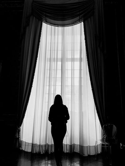 Curtain Indoors  Silhouette Real People One Person Window Women Lifestyles Architecture Adult Day Glass - Material Standing
