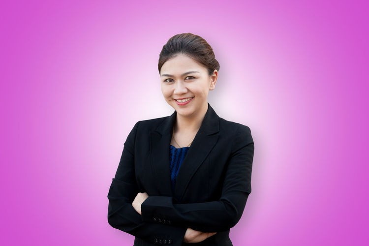 Asia business woman crossed arms portrait Asian  Isolated Office Smart Thai Work Arms Crossed Background Book Business Businesswoman Color Confidence  Happiness Looking At Camera Manager Notebook Portrait Pretty Professional Smiling Studio Shot Style Success Suit
