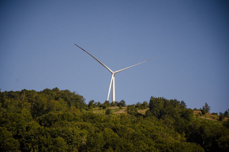 Low angle view of windmill against clear sky