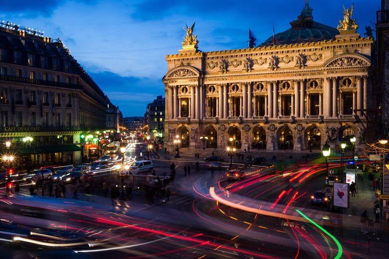 Light trails by opera garnier in city at night
