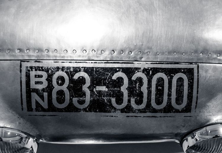 Close-up of text on old car