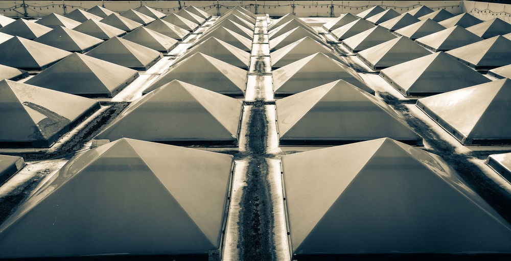 Geometric Shape Pattern Full Frame Triangle Shape Symmetry Architecture Close-up Rooftops One Point Perspective Monochrome Grayscale Skylights Repeating Patterns Buildings Design Mid Century Architecture Style Details