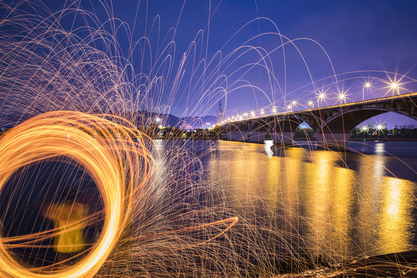 fire the bridge Light Painting Architecture Bridge - Man Made Structure Built Structure Connection Illuminated Light Trail Long Exposure Motion Nature Night No People Outdoors River Sky Water Wire Wool