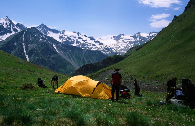 Friends camping by mountains