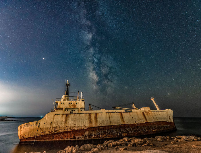Abandoned Ship On Sea At Night