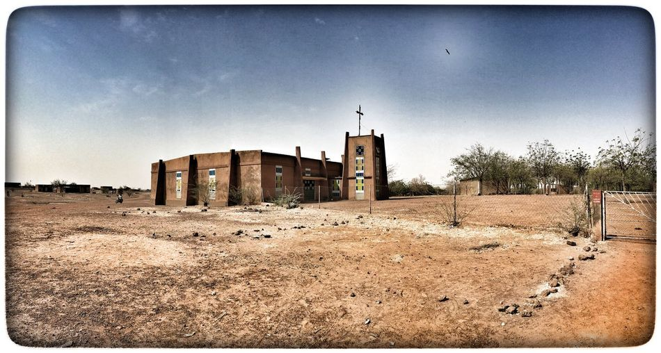 Kirche in Burkina Faso Architecture Building Exterior Built Structure Clear Sky Day Nature No People Outdoors Sand Sky