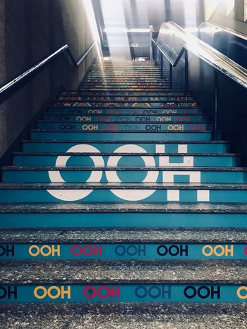 Script Escalator Ooh Steps City Life City Rome Subway Station Subway Underground Station Text Colors Colorful Stairs Text Western Script Communication Number No People Day Indoors