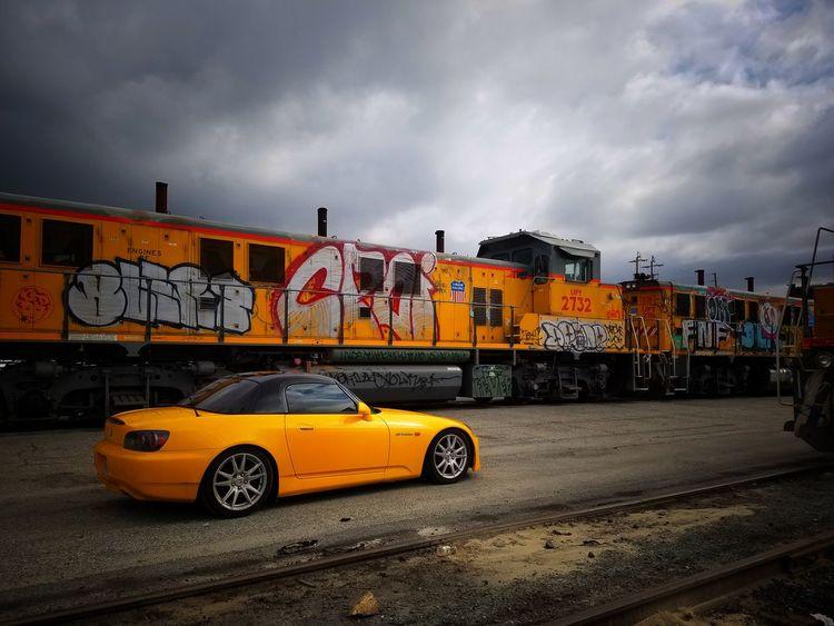 Wherever it takes me Yellow City Outdoors City Street Car No People Day Mindbodysoul Urban Skyline Train Traintracks Graffiti Art