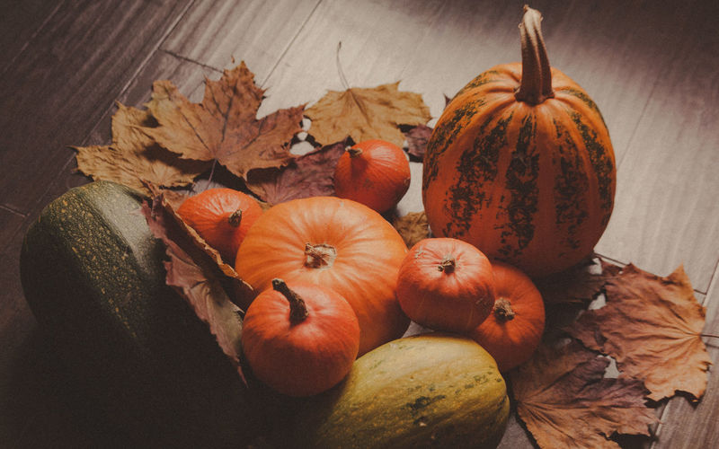 Autumn Pumpkin Thanksgiving Background Autumn Autumn colors Autumn Autumn🍁🍁🍁 Background Close-up Food Food And Drink Freshness Healthy Eating High Angle View Indoors  Leaf Leaves Maple Leaf Nature No People Orange Color Pumpkin Squash - Vegetable Still Life Vegetable Wellbeing Wood - Material