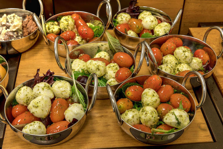Mozzarella cheese, tomato and basal salad in small stainless steal single serving bowls. Salad Small Salad Motzerella Mozzarella Cheese Cheese Tomato Basil Small Portion Salad Bowl Buffet Light Lunch Lunch Gourmet Gourmet Food Meal Natural Organic
