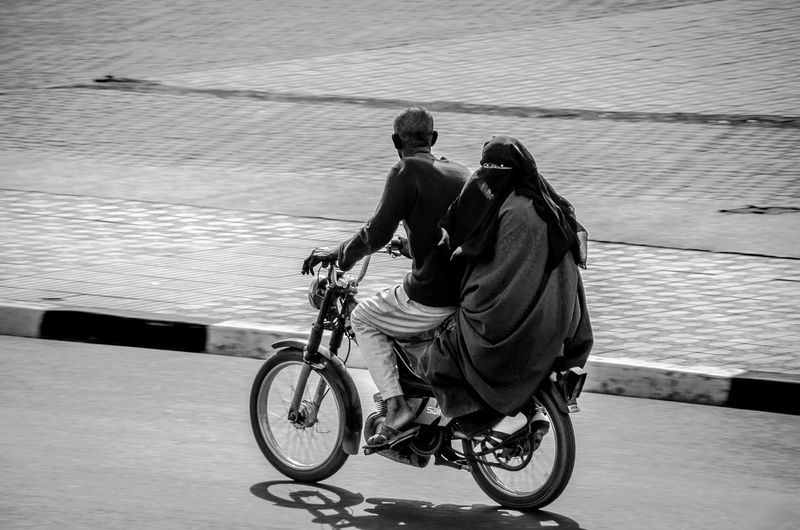 Couple Riding Bicycle In Morocco