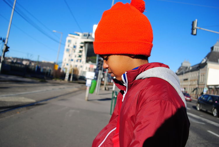Alone Annoyed Annoyedface Blue Sky Boy City Life Hopeless Mixed Breed Portrait Red Hat Schoolboy Standing
