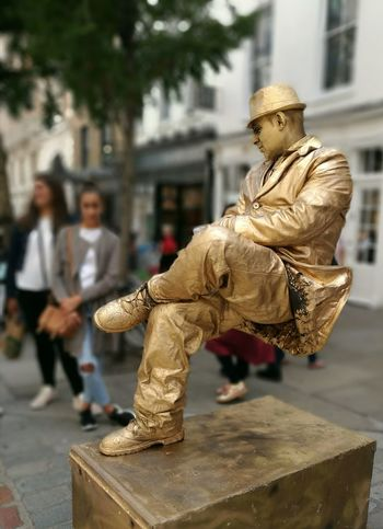Arts Culture And Entertainment Outdoors Sculpture Statue Full Length Gold Colored City Day Adult Street Performer Gold Man The Week On EyeEm