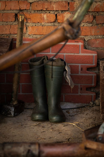 Ranch Boots Wellies  Abandoned Architecture Brick Brick Wall Building Building Exterior Built Structure Day Focus On Background Outdoors Rubber Boots Selective Focus Wall Wall - Building Feature Working Environment