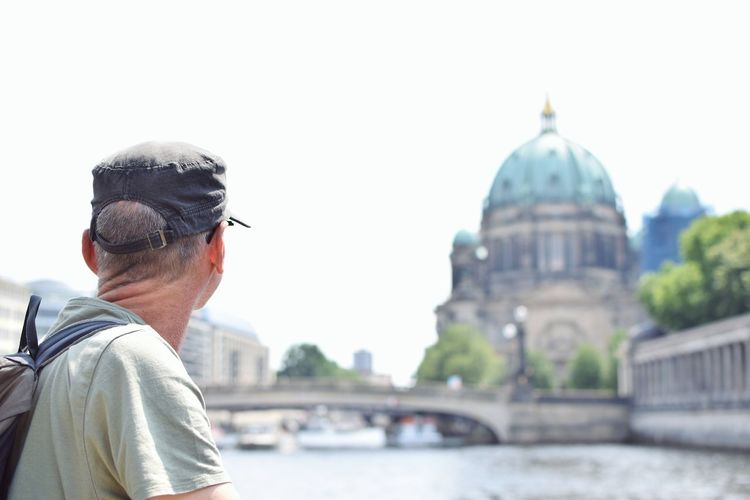 Rear view of man looking at berlin cathedral