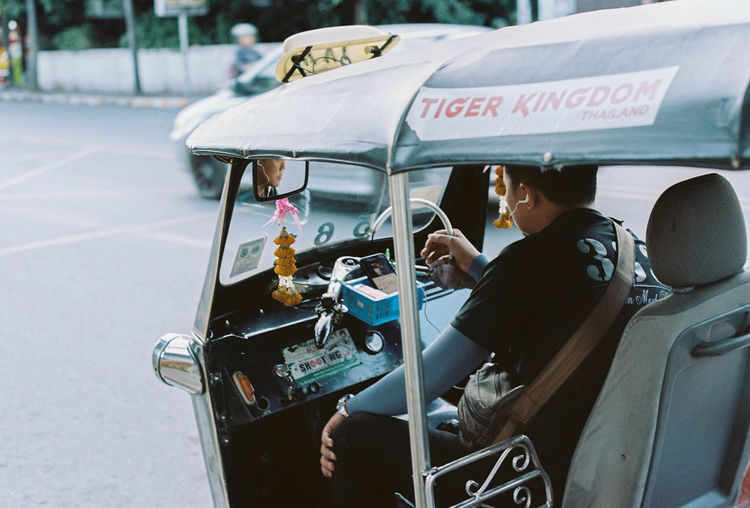 Potra 160 + Yashica TL Electro X The Art Of Street Photography Real People Transportation Mode Of Transportation Street City Car Men Land Vehicle Motor Vehicle People Day Lifestyles Two People Driving Outdoors Road Incidental People Travel Sitting Streetphotography TukTuk Thailand City Urban Film Film Photography