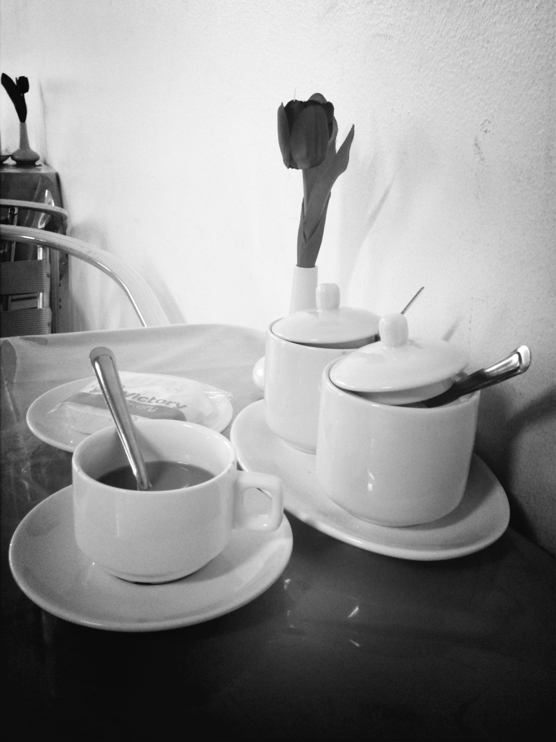 indoors, table, still life, coffee cup, drink, refreshment, home interior, food and drink, cup, coffee - drink, wall - building feature, one person, chair, bottle, reflection, bathroom, empty, coffee, sitting, hygiene