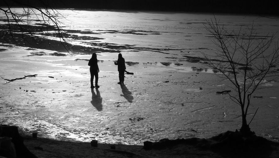 High angle view of silhouette people on beach