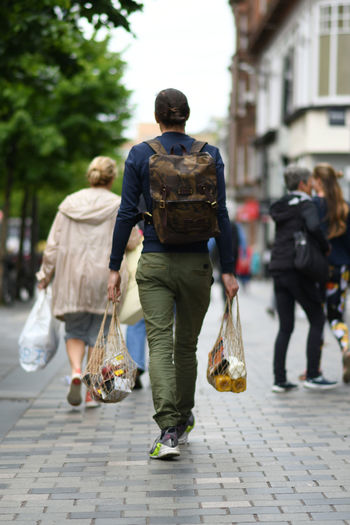 City Walking Rear View Full Length Incidental People Street Real People Bag Women Architecture Lifestyles Men Adult Two People Day People Footpath Casual Clothing City Life Outdoors Shopping Bags Shopping Bags Glasgow