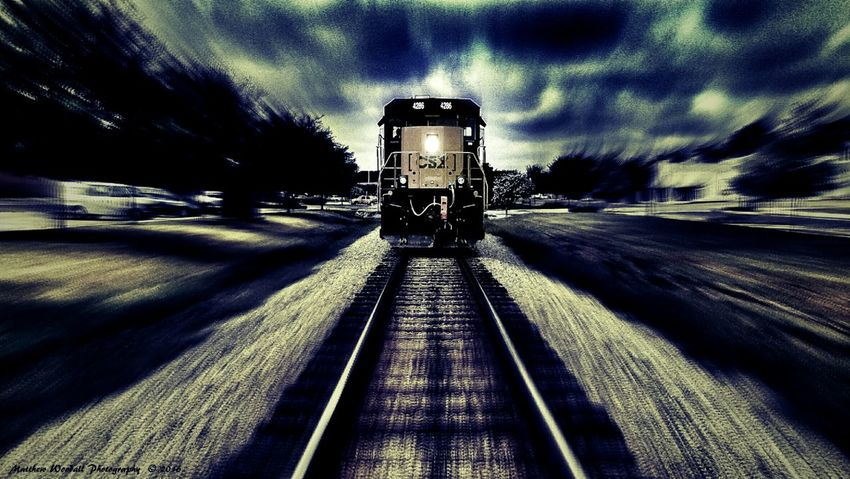 """""""Dead on track 2"""" This is a new edit on a photo that I posted a couple of days ago entitled 'Dead on track '. In the other one it shows it as it was when I took the photo in the cloudy afternoon, but being that the trains headlight was on clearly, I thought that it might look cool if I could make it appear as if it were in the twilight time of the evening, right at the time it began to turn night time. So I decided to make it darker using a couple of filters in snapseed and also tuning the settings to darken it with the contrast and took out some brightness and also toned it down using the shadow settings, to give it just the right settings for a twilight appearance. I hope that you like my efforts. On other photo and social media websites people like it a lot and have given me great compliments on my editing efforts, and I can only hope that you all here will like it as well. I thank you sincerely if you do like my editing of this fast looking train at twilight. :-) ✌ Creative Photography Trainphotography Railfansofeyeem Railroad Track Fast Train Twilight Scene Twilightscapes Twilight Trains & Railroad Trains_r_the_best Trains Trains_worldwide Railways_of_our_world Railroad Love Trainride Trainstories Train_of_our_world Railfans_of_instagram Railfanning Fujifilmdigitalcamera Fujifilm Photoshop Edit Picasaedit Snapseed Picasa"""