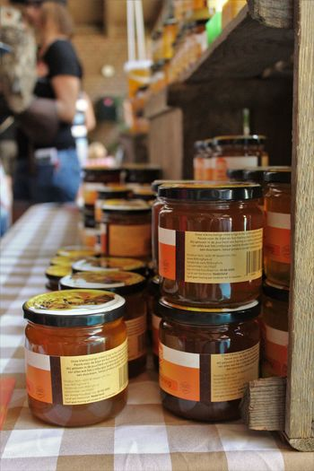 In A Row Jar Of Honey See What I See Walking Around Taking Pictures Business Container Focus On Foreground Food Food And Drink Group Honey Honey ❤ In A Row Incidental People Jar Jars In A Row Large Group Of Objects Market Outdoors People Real People Retail  Still Life Table Variation