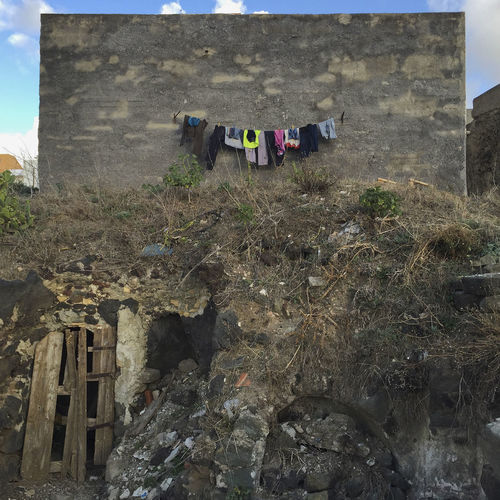 Clothes drying on rock against building