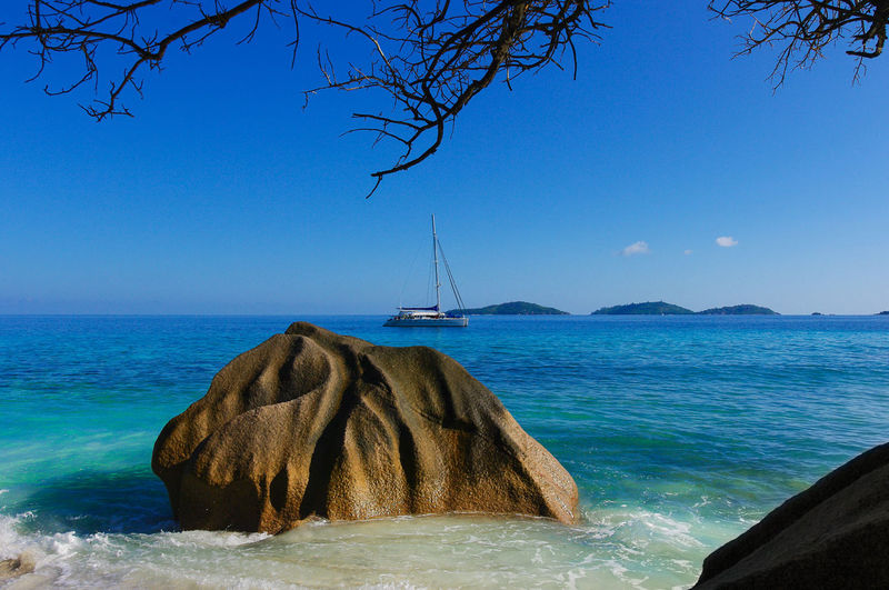 Seychelles Nature Beauty In Nature Scenics - Nature No People Seychelles Beach Sand White Sand Palm Tree Travel Destinations Paradise Paradise Beach Ocean Natuer_collection Nature Colorful Sky Stone Rocks Rock - Object Green Color Beauty In Nature Africa Cloud - Sky The Great Outdoors - 2019 EyeEm Awards
