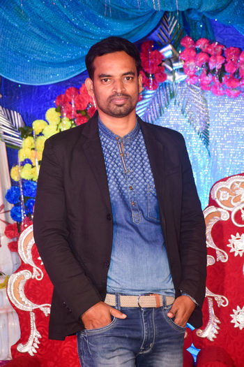 Young man standing in a marriage function with black blazer and jeans Looking At Camera Portrait One Person Smiling Front View Young Adult Young Men Men Standing Real People Three Quarter Length Casual Clothing Waist Up Adult Lifestyles Indoors  Happiness Leisure Activity Blazer Black Function Marriage