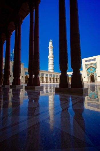 Blue Reflection Place Of Worship Modern Art Architectural Column Mosques Of The World Architecture Photography Blue Sky Visit Oman