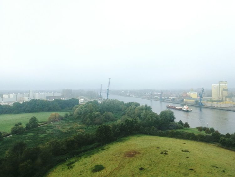 Water River Kiel Canal Connection Engineering Built Structure Architecture Suspension Bridge Tranquility Travel Destinations Riverbank Tranquil Scene Growth Distant Day Outdoors Nature Fog Schleswig-Holstein Scenics Landscape North Germany Channel Canal Nord Ostsee Kanal