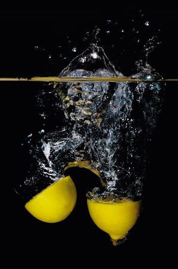 Water splashing by lemons Close-up Day Food Food And Drink Freshness Fruits Indoors  Lemon Splashing Studio Shot Water Yellow