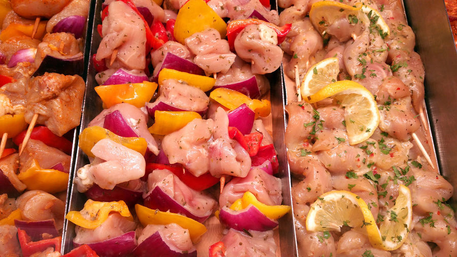 Full frame shot of marinated kebabs for sale at market stall