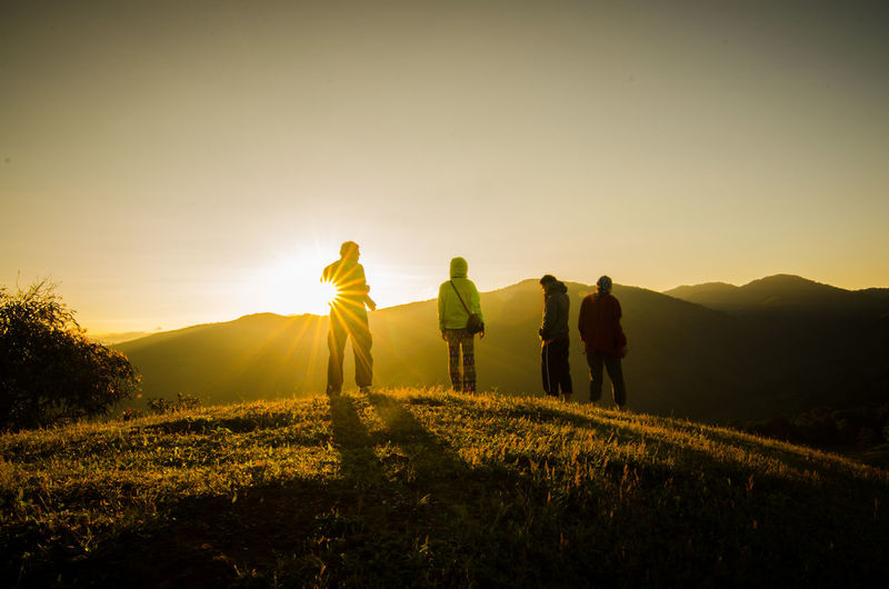 Group Of People Celebration Cheerful Sunset Concept Celebration Hiking Mountaineer Mountaineering Silhouette Adult Adults Only Beauty In Nature Clear Sky Day Friendship Grass Group Of People Hiker Landscape Lifestyles Men Mountain Nature Outdoors People Real People Rear View Scenics Silhouette Sky Sun Sunbeam Sunlight Sunrise Sunset Togetherness Walking Women