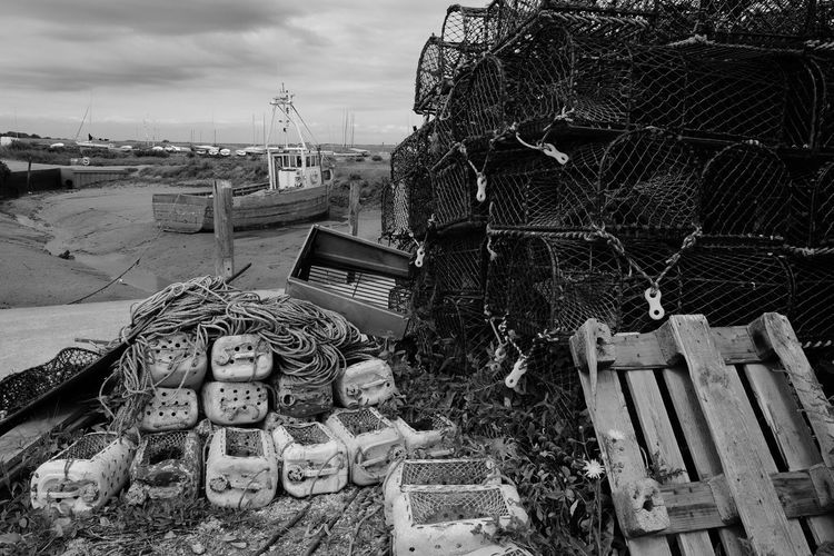 Brancaster Staythe harbour, Norfolk, UK. Crab Lobster Pots Boat Fishing Industry English England Uk Norfolk Harbor Harbour Brancaster Staithe