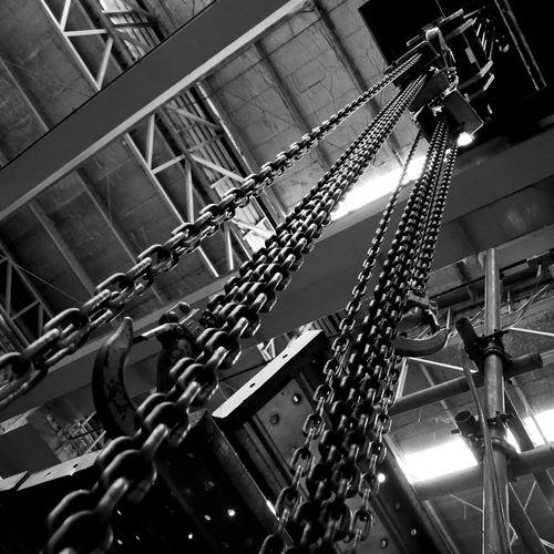 Low angle view of illuminated lighting equipment hanging on railing