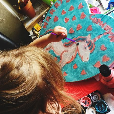 Little Girl Unicorn Painting By Child Unicorn Child Painting Childs Art Painting Childhood Child Real People Indoors  High Angle View Craft Women Adult Thread Needle Sewing Needle Textile Multi Colored Skill  Table Human Hand Leisure Activity