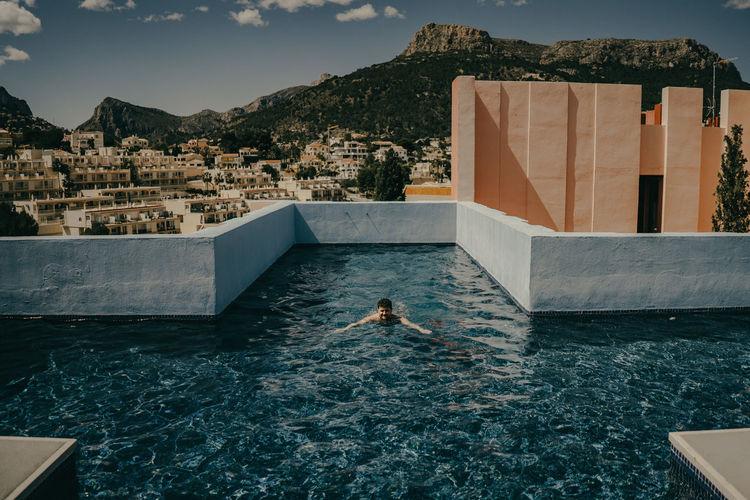 Man swimming in pool at resort