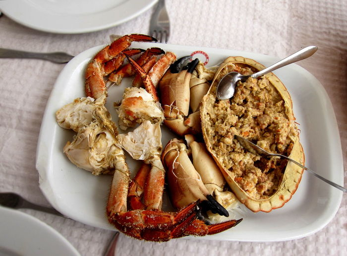 Traditional Portuguese seafood dish brown crab (Cancer pagurus), known as Sapateira Recheada Crab Dinner Meal Nature Portugal Seafood Shelfish Brown Crab Cooked Crab Body Delicious Diminishing Perspective Food Healthy Eating Lisbon Ocean Sapateira Sapateira Recheada Sea Traditional