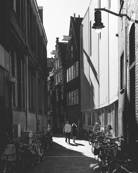 Architecture Building Exterior Built Structure Street Bicycle City Outdoors Transportation Day City Life Land Vehicle Men Real People Lifestyles Women People Adult Adults Only Sky Only Men