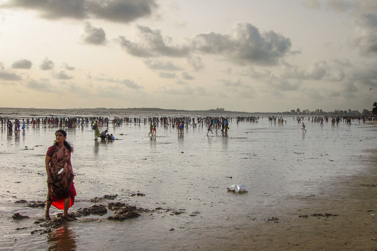 Juhu Beach scene India Woman Adult Beach Cloud - Sky Clouds Colorful Crowd Group Of People Land Large Group Of People Leisure Activity Lifestyles Men Nature Outdoors Real People Sand Sea Sky Vacations Water