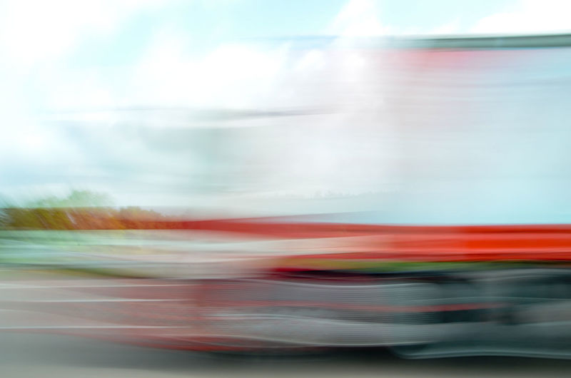 Blur image of truck on road